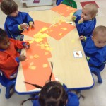 Glueing yellow tissue paper on a sun