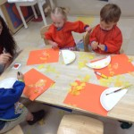 Toddlers making a yellow sun